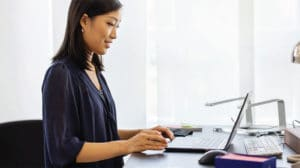 Image of a woman engaging in a virtual coaching experience on laptop